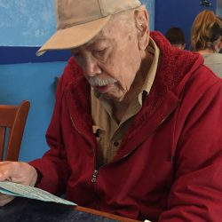 97-year-old Sal Meraz reading the restaurant menu without glasses